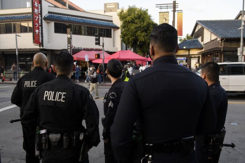 LAPD officer shoots transgender rights protester at close range in viral video