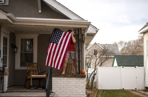 """Homeowner refusing to remove """"F*** Biden"""" flags faces $500-a-day fine"""