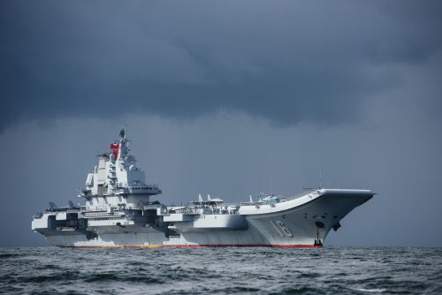 U.S. Navy warship shadows China aircraft carrier in video