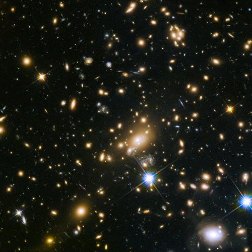 Images of galactic clusters reveal early galaxies underwent periods of violent star formation