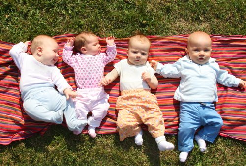 Woman expecting one baby has four, quadrupling size of family overnight