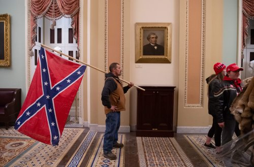 """Man calls child """"f***ing r****d"""" for questioning his Confederate flag in video"""