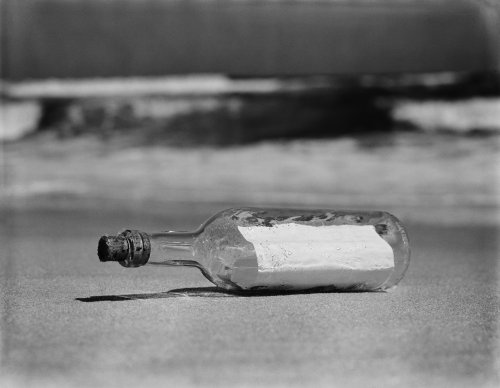 Man finds literal message in a bottle hidden in walls of house during home renovation