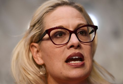 Kyrsten Sinema gets $4,000 from banks, debt collectors after nixing $15 minimum wage