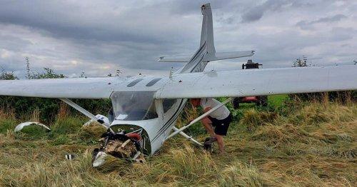 Plane crash lands in field