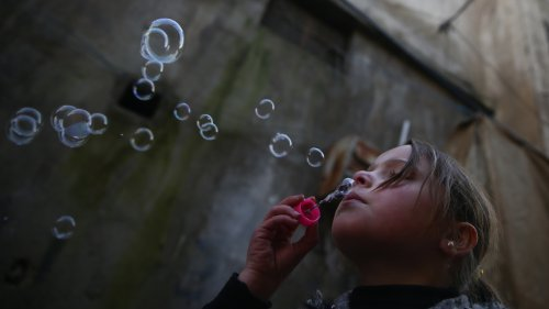 Blowing Bubbles And Running From Bombs: The Reality Of War For The Children Of Syria