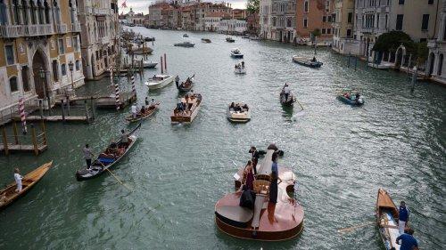 Watch A Massive Violin Transport Musicians Down Venice's Grand Canal