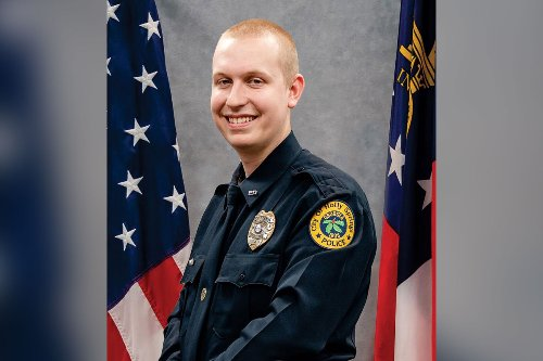 Georgia police officer dead after being dragged by speeding motorist he shot, killed