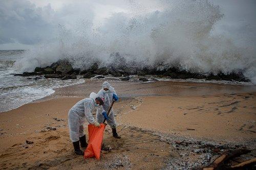 Fire-ravaged ship sinks off Sri Lanka, prompting pollution fears