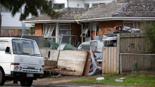 Rubbish spilling out of West Auckland state home, blocking footpath - NZ Herald