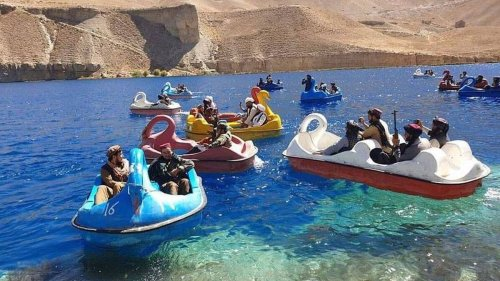 Fall of Afghanistan: Taliban fighters ride pedalos on lake, female employees in Kabul told to stay home - NZ Herald