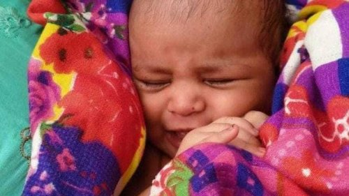 Baby girl found floating down Ganges in wooden box - NZ Herald