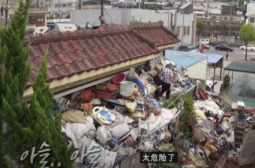 Man Spends 10 Years Hoarding Tons of Garbage as Dowry for His Son