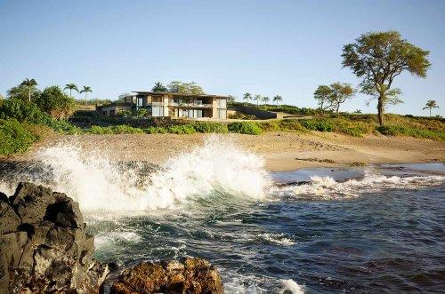 A breezy sustainable beach house perched on the idyllic Maui coastline