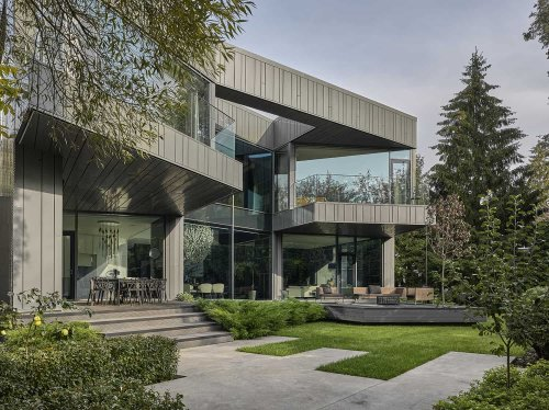 Jaw-dropping luxury family home in Russia surrounded by a pine forest