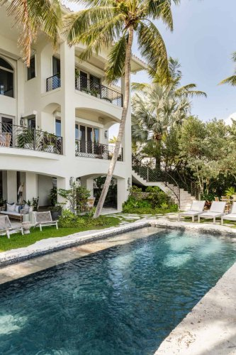 Tour a gorgeous hacienda Spanish style retreat overlooking Biscayne Bay