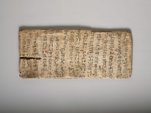 A 4,000-Year-Old Student 'Writing Board' from Ancient Egypt (with Teacher's Corrections in Red)