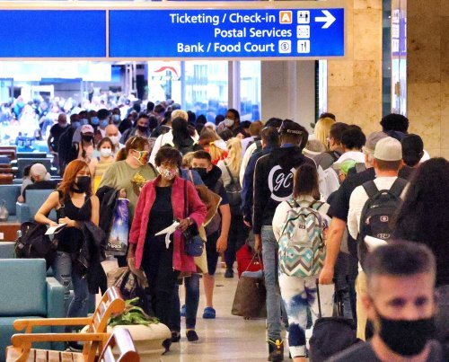 Orlando airport rebounds from pandemic's slowest day to crowded ticket counters before dawn