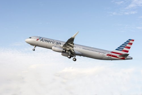 Emergency Slide Seperates From American Airlines Jet as it Takes Off at Miami International Airport