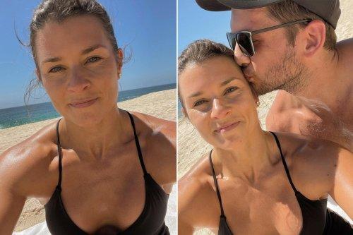 Danica Patrick cozies up to boyfriend Carter Comstock in beach pics