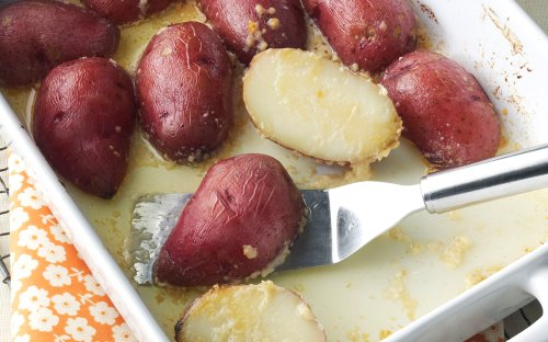 Parmesan Baked Potatoes Are A Buttery, Budget-Friendly Side Dish