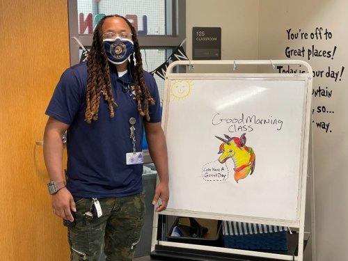 Custodian's Whiteboard Artwork Cheers, Motivates New Hope Kids