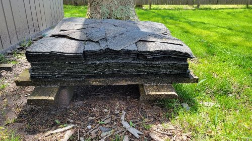 "Question from your neighbor: ""Anyone want these roofing shingles?"""