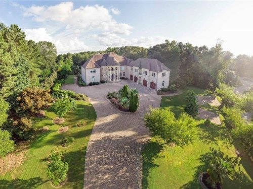 $3.5M Roswell Mansion Has 50+ Car Driveway, Helicopter Pad