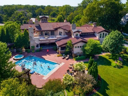 $7M Naperville Home With In-Ground Pool, Hot Tub, 12 Fireplaces