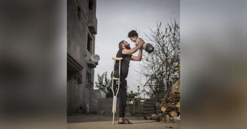 Emotional Shot of Father Holding Son Wins Siena Photo Awards 2021