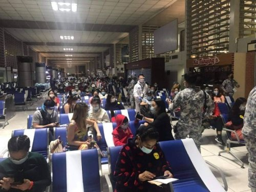 DFA repatriates another 155 Filipinos from China