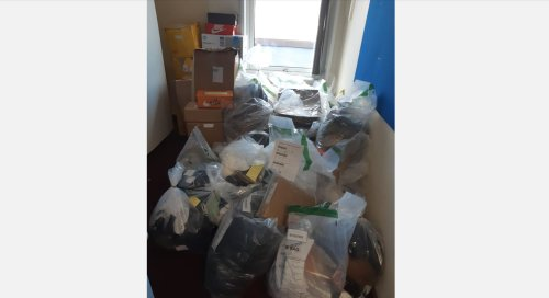 Two Luton men arrested after more than 300 items of designer clothing seized