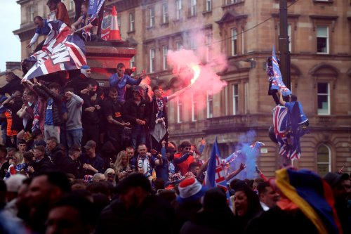 Police officers injured and more than 20 people arrested after Rangers title celebrations