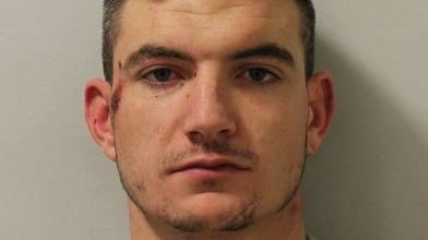 Man who rammed police cars and attacked officers jailed