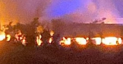 Huge property fire burns through the night and closes major road