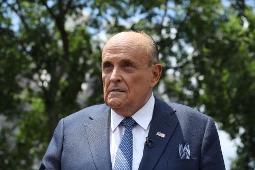 Giuliani cuts down his entourage