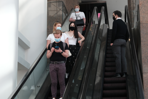 States, retail giants lift mask mandates