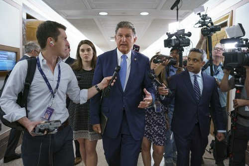 Manchin weighs another term as his influence peaks