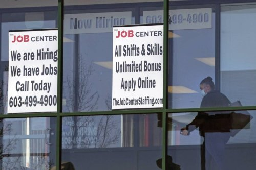 U.S. jobless claims drop to 385,000, another pandemic low