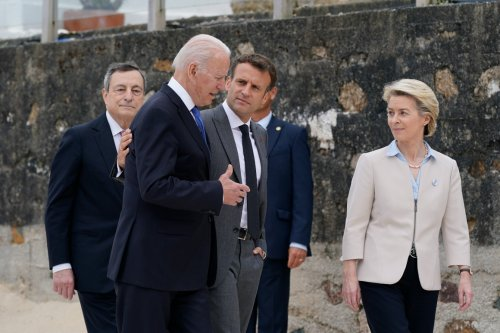Biden revels in Trump's absence from the world stage