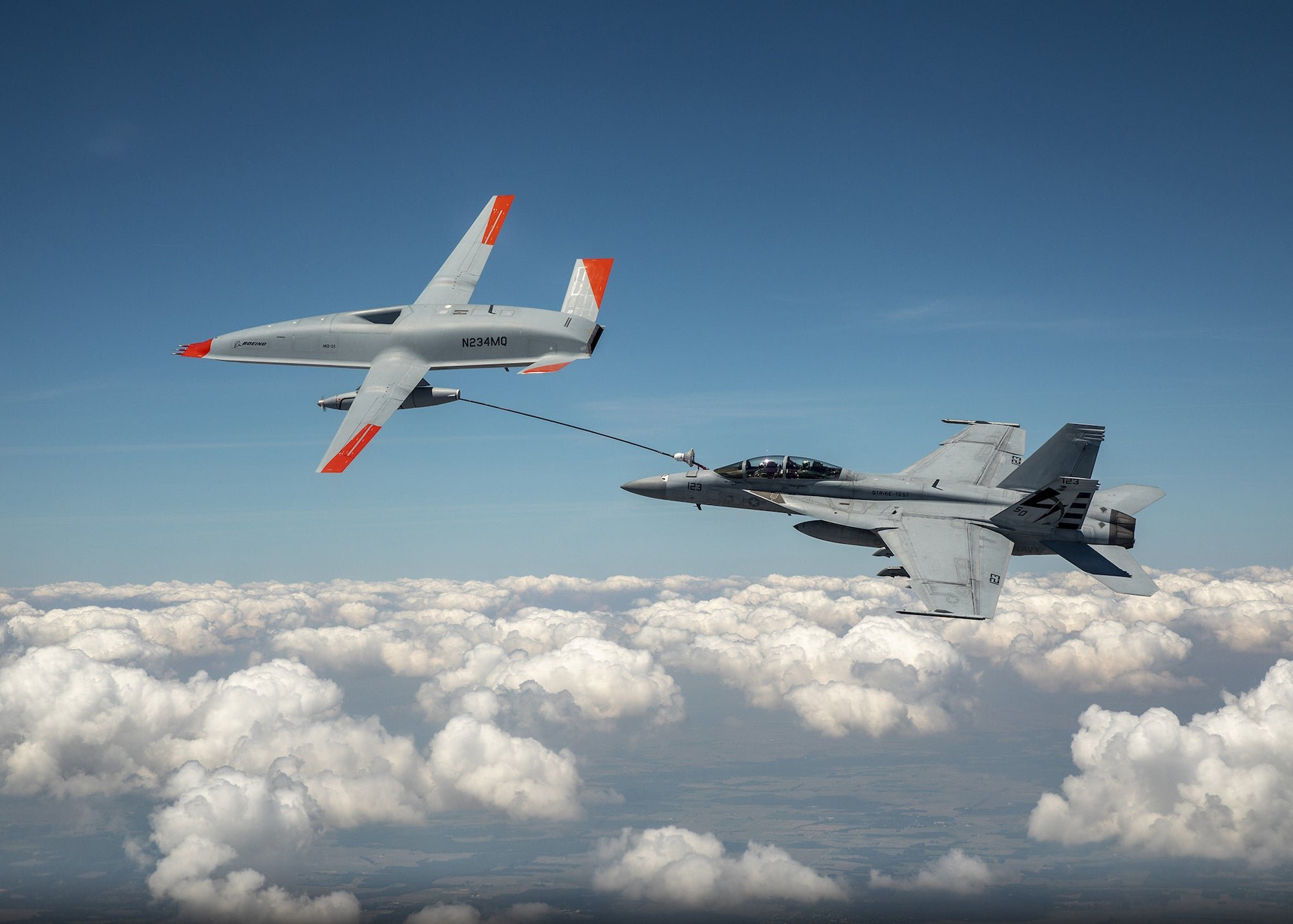 A drone and fighter jet just made 'wet contact' for the first time ever - cover