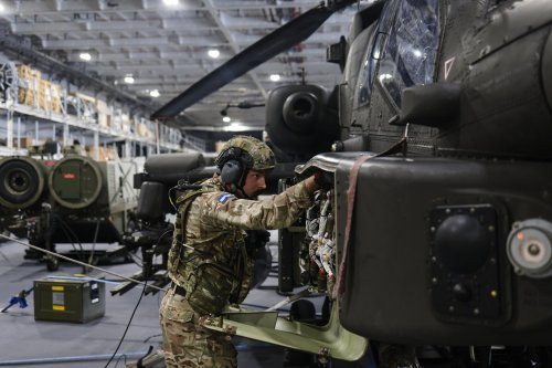 Army pilots from 656 Squadron fly Apache helicopters on HMS Prince of Wales