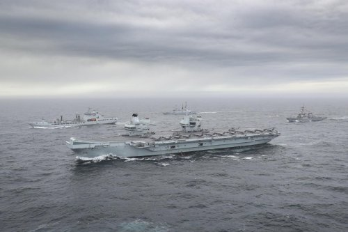 Aircraft carrier HMS Queen Elizabeth launches helicopters' first sorties at sea