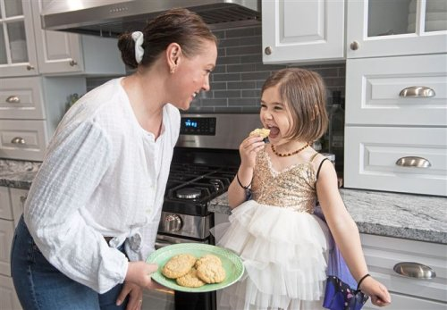 Mom and daughter make orange-vanilla sugar cookies sweeter