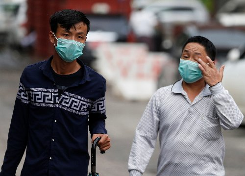 Men wear masks to protect themselves from H1N1 in Yangon, Myanmar.