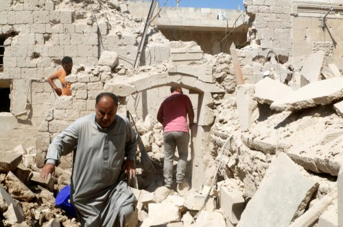 Residents inspect their damaged homes after an airstrike on the rebel-held Old Aleppo, Syria on Aug. 15.