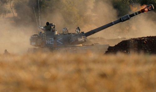 Israel deploys ground troops to Gaza border as conflict escalates