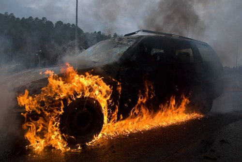 PHOTO: Hummer bursts into flames outside gas station after man is found hoarding fuel