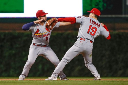 Cardinals match record with 14th straight with 12-4 win over Cubs