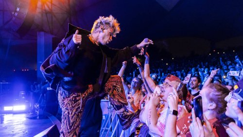 Machine Gun Kelly launches punch at fan after crowd storm stage at Louder Than Life gig